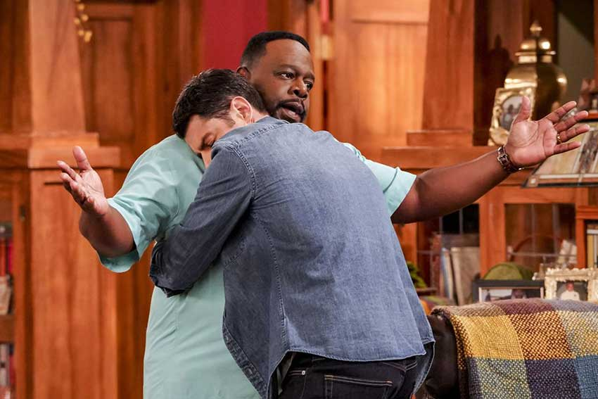 Cedric the Entertainer and Max Greenfield in The Neighborhood